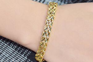 Bracelet doré de Di Lusso